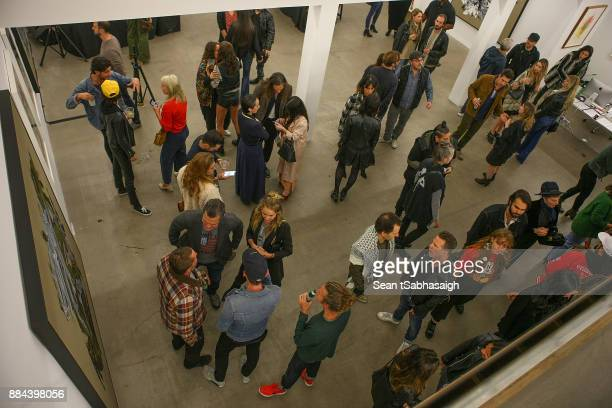 A general view from above showing the gallery space at OptiMystic A Brandon Boyd Pop Up Gallery Featuring He Tasya Van Ree Natalie Bergman Diana...