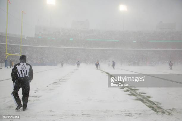 General view from field level as crews work to clear yard lines during the first quarter between the Buffalo Bills and the Indianapolis Colts at New...