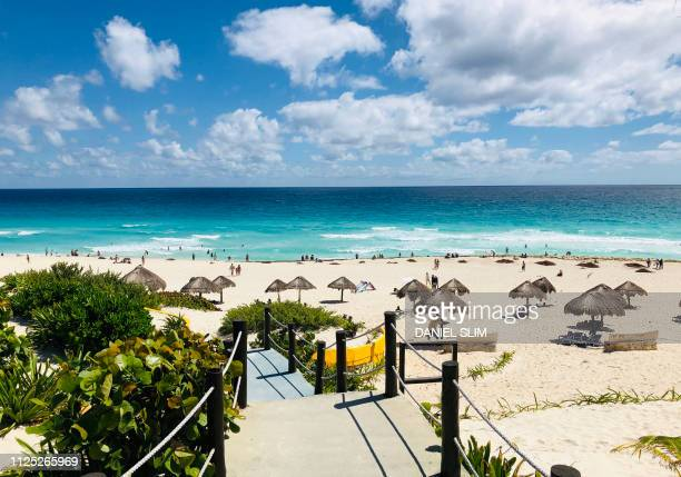 A general view from one of the accesses to the beach area with palapa umbrellas in Cancun Quintana Roo State Mexico on February 16 2019 Playa del...