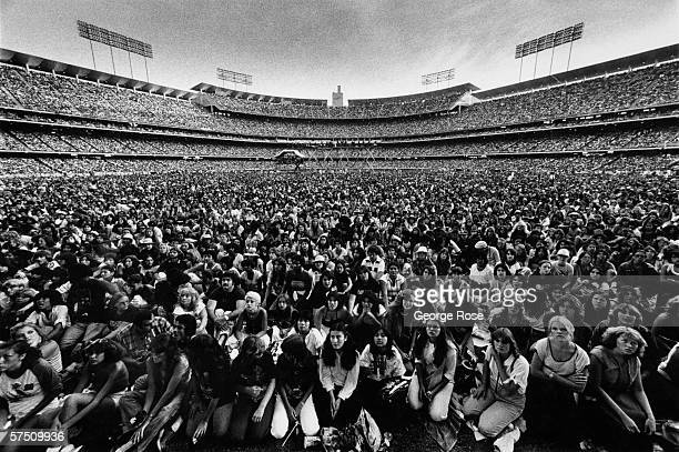 A general view from onstage of the amassed audience as the Bee Gees perform in a rare 1979 Los Angeles California concert at Dodger Stadium A crowd...