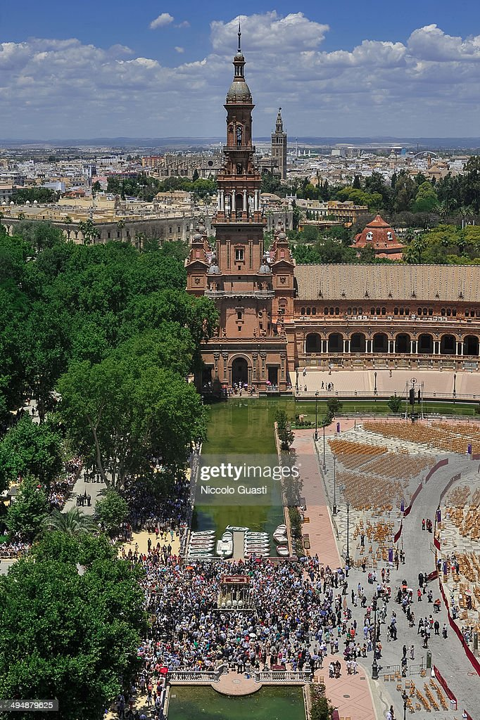 A general view from 'Plaza de Espana's South Tower of the palanquin with the figure of the Virgin leaving the 50th Anniversary of 'La Macarena' crowning in the 'Plaza de Espana' Square on May 31, 2014 in Seville, Spain. Seville locals and visitors from around the world come in the masses to observe the grande celebration of the Jubilee Year of La Macarena held to mark the 50th anniversary of the canonical coronation of the Virgin of La Macarena, a 17th century Roman Catholic wooden image of the Blessed Virgin Mary venerated in Seville and one of the city's most popular symbols.