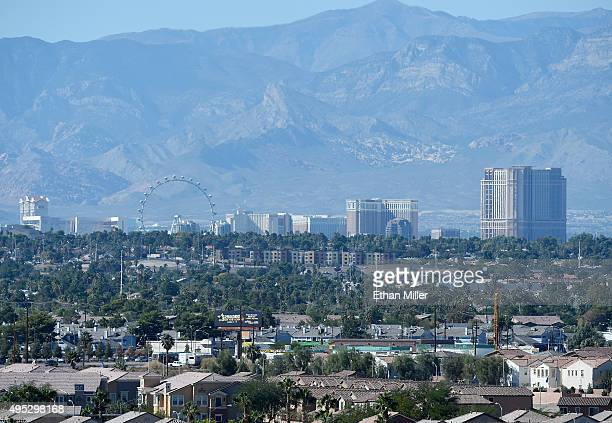 A general view from Sam Boyd Stadium shows the Las Vegas Strip behind homes on October 31 2015 in Las Vegas Nevada
