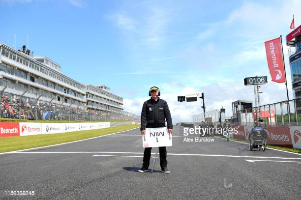 General view from the grid as a marshal prepares to hold up a 1 min sign prior to the start of Race One of the British Superbike Championship at...