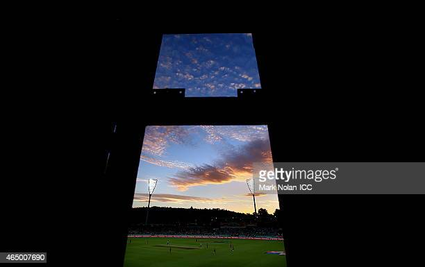 A general view from the scoreboard as the sun sets over the ground during the 2015 ICC Cricket World Cup match between South Africa and Ireland at...