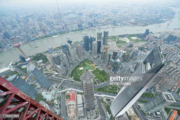 A general view from the top of the under construction Shanghai Tower shows the 492m Shanghai World Financial Center the 421m Jin Mao Tower and the...