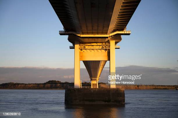 General view from the underside of the Severn Bridge which links Wales and England via the M48, at sunset on October 15, 2020 in Beachley, England....