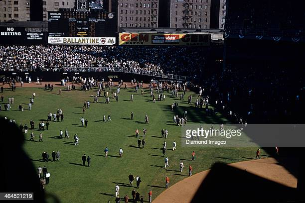 A general view from the upper deck of the playing field as fans leave the stadium by walking across the outfield grass to the exits underneath the...