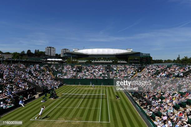 A general view in court two as Daniel Evans of Great Britain plays Nikoloz Basiashvili of Georgia during Day four of The Championships Wimbledon 2019...