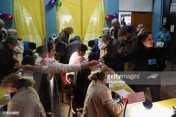 A general view inside a polling station in Simferopol on March 16 2014 in Simferopol Ukraine Crimeans go to the polls today in a vote that which will...