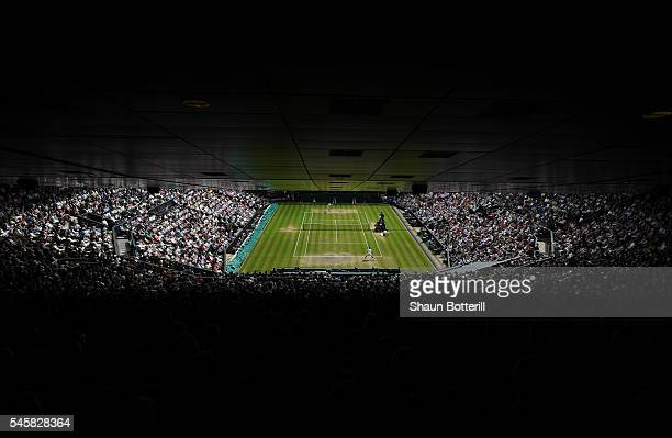 A general view inside Centre Court as Andy Murray of Great Britain and Milos Raonic of Canada are in action during the Men's Singles Final on day...