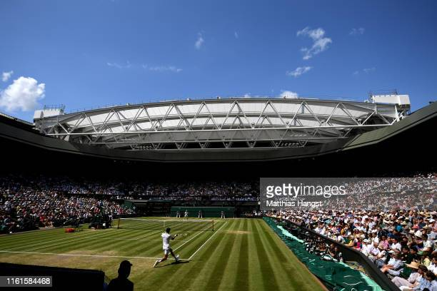 General view inside centre court as Novak Djokovic of Serbia plays a forehand in his Men's Singles semi-final match against Roberto Bautista Agut of...