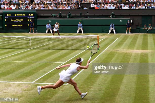 A general view inside centre court as Simona Halep of Romania stretches to play a forehand in her Ladies' Singles final against Serena Williams of...