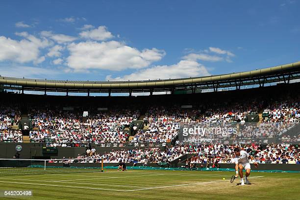 A general view inside court one as Milos Raonic of Canada plays a backhand during the Men's Singles Quarter Finals match against Sam Querrey of The...