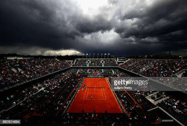 A general view inside Court Philippe Chatrier as coulds begin to form during the ladies singles Quarter Finals match between Kristina Mladenovic of...