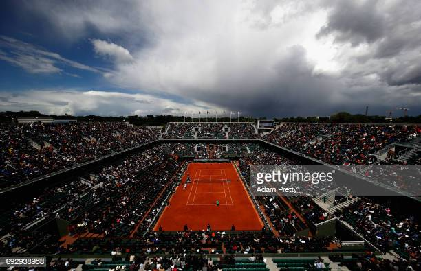 A general view inside Court Philippe Chatrier as coulds begin to form during the ladies singles Quarter Finals match between Kristina Mlandenovic of...