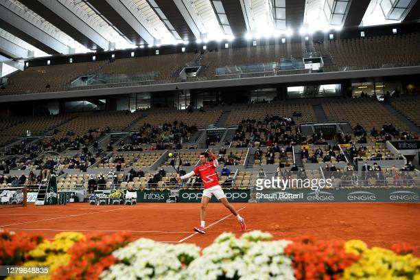 General view inside Court Philippe-Chatrier as Novak Djokovic of Serbia plays a backhand during his Men's Singles Final against Rafael Nadal of Spain...