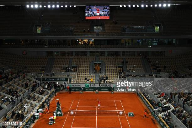 General view inside Court Philippe-Chatrier as Novak Djokovic of Serbia celebrates after winning match point during his Men's Singles fourth round...