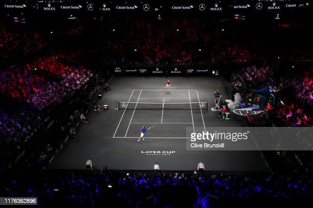General view inside the arena as Roger Federer of Team Europe plays a forehand in his singles match against John Isner of Team World during Day Three...