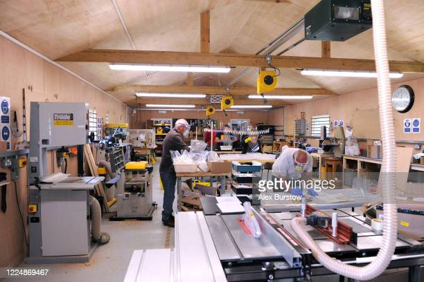 A general view inside the Church Crookham and Fleet Men's Shed as 'Project Shield' volunteers help to produce fullface visors for those in need in...