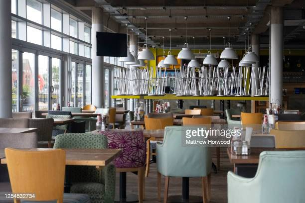 General view inside the closed Mount Stuart Wetherspoon pub on July 5, 2020 in Cardiff, United Kingdom. Lockdown restrictions continue to be eased in...