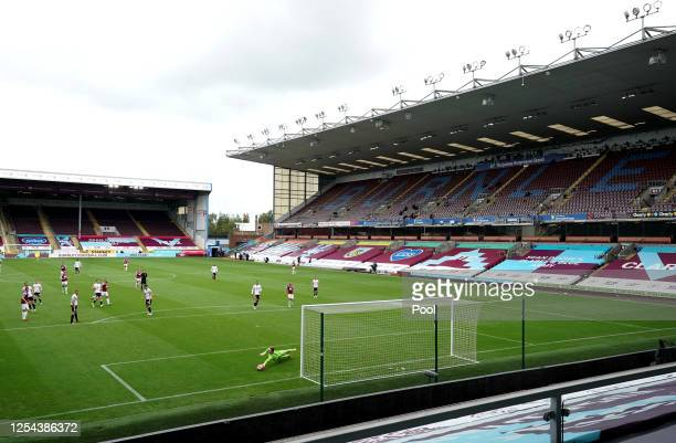 General view inside the empty stadium as Dean Henderson of Sheffield United makes a save during the Premier League match between Burnley FC and...