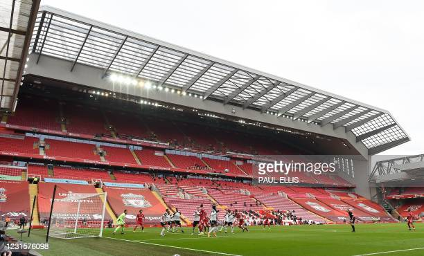 General view inside the empty stadium is pictured during the English Premier League football match between Liverpool and Fulham at Anfield in...