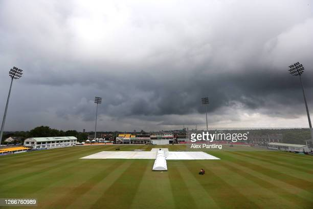 General view inside the ground as the covers are brought out as play is delayed due to rain during day three of the Bob Willis Trophy match between...