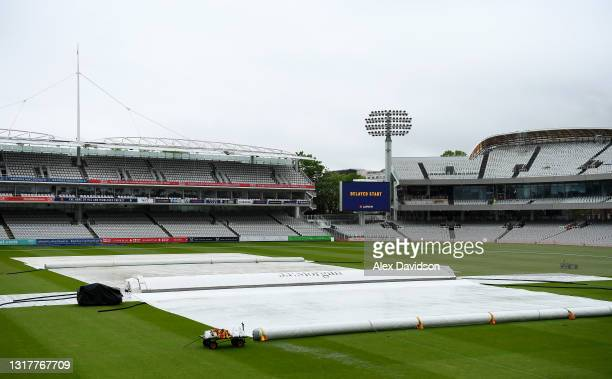 General view inside the ground as the start of play is delayed due to rain on Day One of the LV= Insurance County Championship match between...