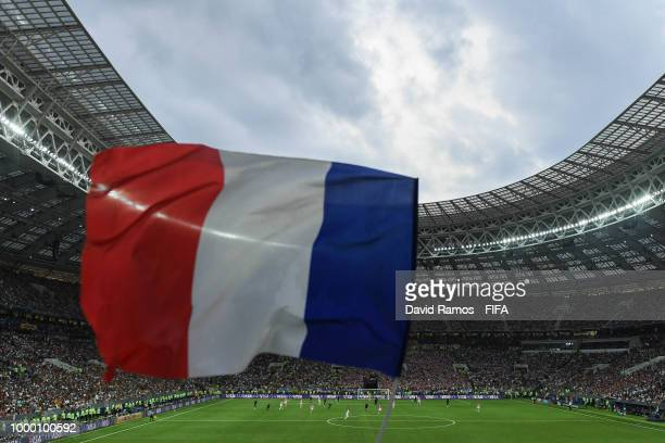 A general view inside the stadium as a France flag is flown in support during the 2018 FIFA World Cup Russia Final between France and Croatia at...