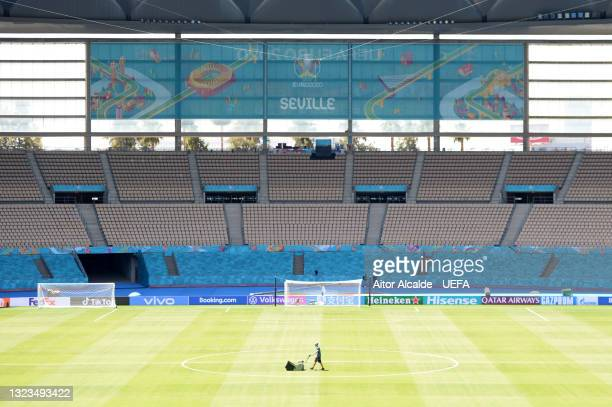 General view inside the stadium as a member of ground staff prepares the pitch prior to the UEFA Euro 2020 Championship Group E match between Spain...