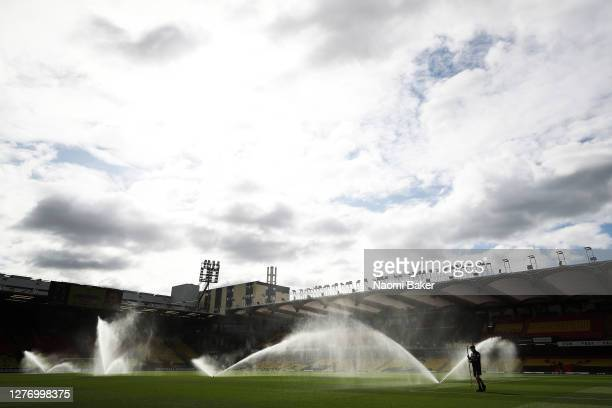 General view inside the stadium as a member of the grounds staff tends to the pitch as sprinklers water the pitch during the Sky Bet Championship...