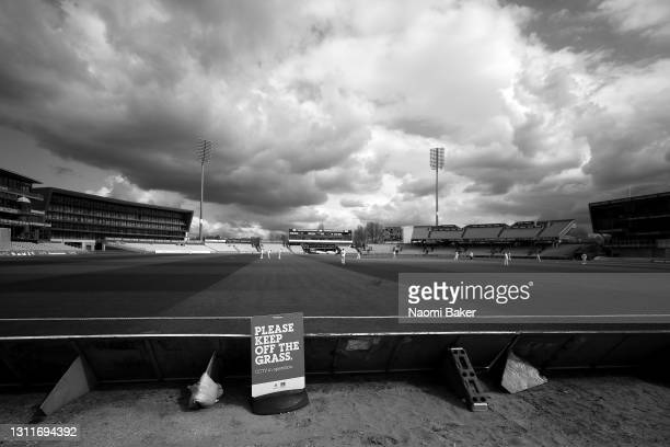 General view inside the stadium as a sign is seen saying 'PLEASE KEEP OFF THE GRASS' during the LV= Insurance County Championship match between...