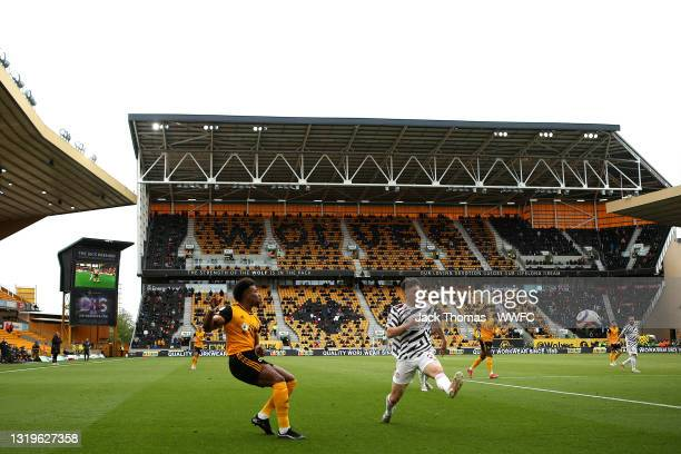 General view inside the stadium as Adama Traore of Wolverhampton Wanderers crosses the ball past Daniel James of Manchester United during the Premier...