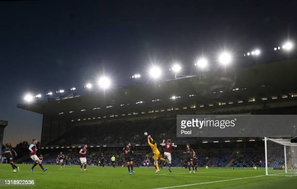 General view inside the stadium as Alisson of Liverpool punches the ball clear whilst under pressure from Chris Wood of Burnley during the Premier...