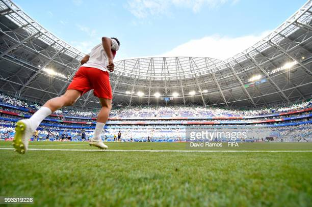 General view inside the stadium as an England Player makes his way on the pich for warm up prior to the 2018 FIFA World Cup Russia Quarter Final...