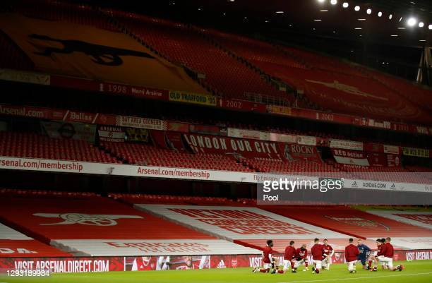 General view inside the stadium as Arsenal players warm up prior to the Premier League match between Arsenal and Chelsea at Emirates Stadium on...