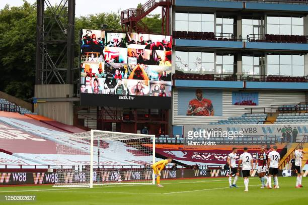 General view inside the stadium as Aston Villa fans watching at home are displayed on the Big Screen, as they react to a missed chance from Aston...