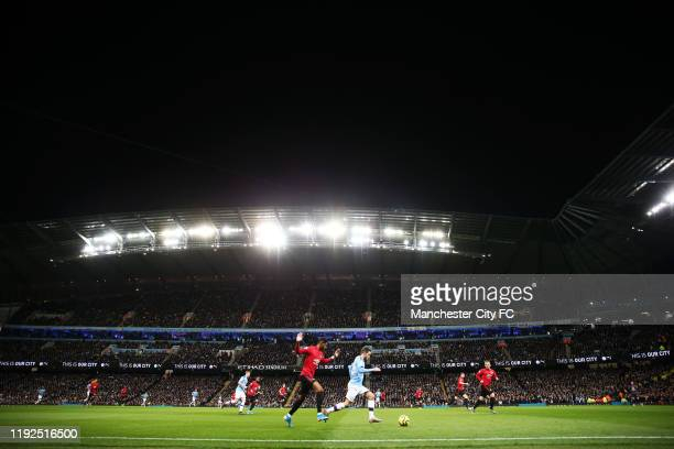 General view inside the stadium as Bernardo Silva of Manchester City battles for possession with Marcus Rashford of Manchester United during the...