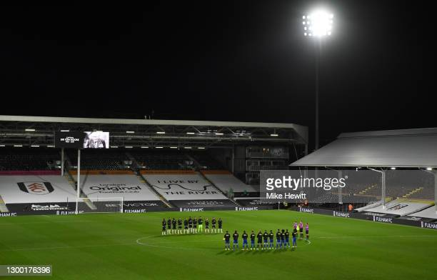 General view inside the stadium as both sets of players take part in a minutes applause in memory of Sir Captain Tom Moore prior to the Premier...