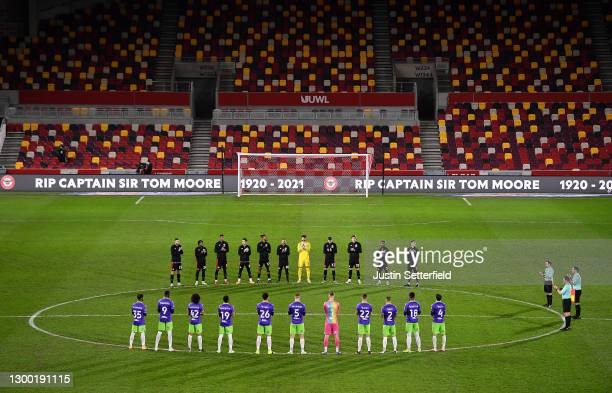 General view inside the stadium as both sets of players take part in a minutes applause in memory of Sir Captain Tom Moore who recently passed away...