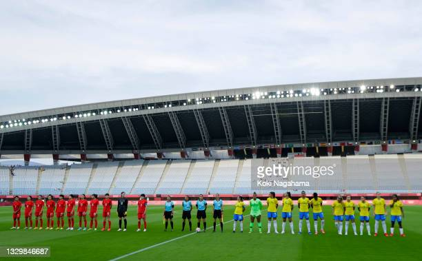 General view inside the stadium as both teams stand for the national anthems prior to the Women's First Round Group F match between China and Brazil...