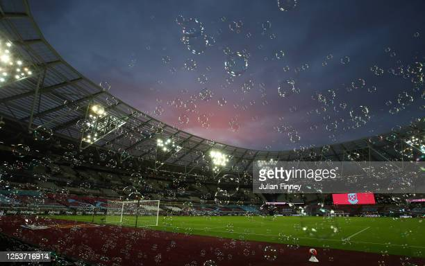 General view inside the stadium as bubbles are blown during the Premier League match between West Ham United and Chelsea FC at London Stadium on July...