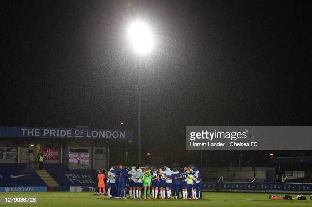 General view inside the stadium as Chelsea players and staff form a team huddle following the FA Women's Continental League Cup match between Chelsea...