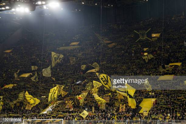General view inside the stadium as Dortmund fans show their support prior to the UEFA Champions League, last 16, first leg football match Borussia...