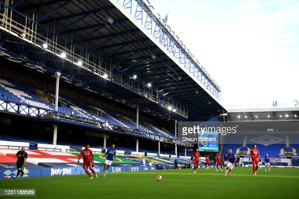 General view inside the stadium as empty stands are seen during the Premier League match between Everton FC and Liverpool FC at Goodison Park on June...
