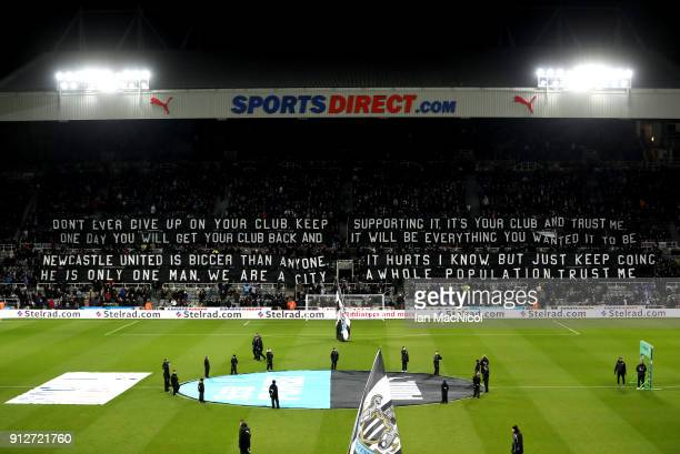 General view inside the stadium as fans display a banner prior to the Premier League match between Newcastle United and Burnley at St. James Park on...