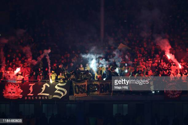 A general view inside the stadium as fans light flares during the DFB Cup second round match between Hertha BSC and Dynamo Dresden at Olympiastadion...