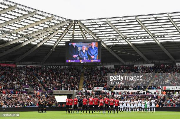 General view inside the stadium as fans, players and officals take part in a minute of applause, to pay tribute to late honorary president Gwilym...