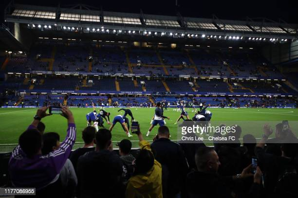 General view inside the stadium as fans take photographs on their phones of players warming up ahead of the Carabao Cup Third Round match between...