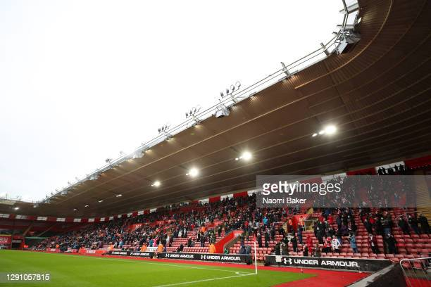 General view inside the stadium as fans take their seats inside the stadium socially distanced and wearing face masks during the Premier League match...